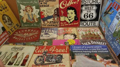 Assorted vintage replica tin signs