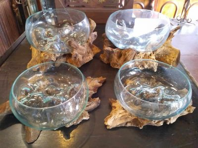 Tree stumps cradling blown glass bowls