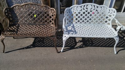2 Cast Iron Outdoor Benches, 1 in a metallic black and brass colour, and the other painted white